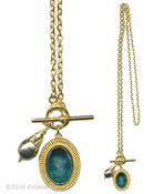 From our Mykonos Collection. Inspired by the beautiful waters off the Greek Island of Mykonos. !n Gold Plate, long necklace with transparent Zircon German glass intaglio pendant and Freshwater pearl charm. Pendant measures 1 by 3/4 inch. Necklace is 27 inhes in length. Each necklace made to order in the USA.