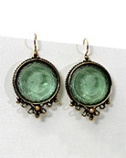 Nearly 1 inch diameter (21 mm) round filigree earring with faux pearl accent.  This tourmaline beauty hangs from gold filled French hooks. Bronze.
