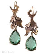 From our Spring Collections, beautiful carved leaf motif with teardrop of transparent Tourmaline green German glass. Stylized shape is very pretty. Earrings measure 1 1/2 inches long by 1/2 inch wide. Bronze metal. Each earring made to order in the USA.