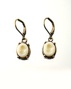 From our Victoriana Collection, small ivory German glass intaglio earring. One of our most popular. Pendant measures not quite 1/2 inch in height. Eurowire hook, Shown in bronze.