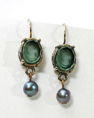 Tourmaline 10/8 mm oval earring with matching freshwater pearl drop hangs from gold filled French hook.
