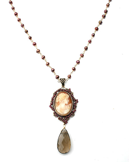 "Cameo necklace. This beautiful hand-carved Italian shell cameo is surrounded by small genuine garnets, with a Smoky Quartz faceted drop. We love this necklace!  Freshwater pearl necklace is 27"", these pearls vary slightly in brightness. Cameo pendant measures 1 1/4 by 1 inch wide approximately. Each necklace made to order in the U.S.A."