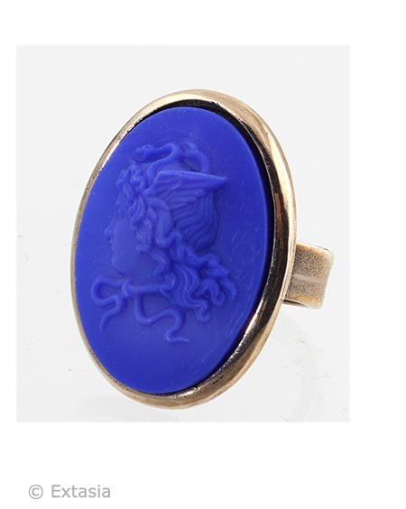 One of our largest ring with our new color, opaque Lapis German glass cameo, with an image from Greek Mythology, Medusa. Clean classic setting in our signature Bronze metal, this ring makes a statement.  In opaque Lapis German glass, a deep bold royal blue. 1 1/4 inches tall. Bronze. Each ring made to order in the U.S.A.