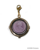 From our Charm du Jour Club Collection, a transparent amethyst hand-pressed German glass intaglio charm. Measuring 1 inch in diameter, the charm comes with a lobster closure to attach to your own chain, or to one of ours, available from this website.