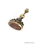From the Charm Collection, our vintage watch fob charm with Buffalo color German glass cameo attached to the bottom face of the piece. In the European tradition of wearing vintage watch fobs as pendants and bracelet charms. Comes with lobster closure to attach to your own chain, or ours.