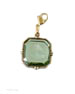 From our Charm du Jour Collection, a transparent Tourmaline German glass intaglio charm. Tourmaline is a beautiful Sea Foam green color. The medium 3/4 inch wide charm comes with a lobster closure to attach to your own chain, or to one of ours, available from this website. Create your own charm bracelet or charm necklace. Available in other stone colors by request. In our signature bronze metal. Each charm made to order in the U.S.A.