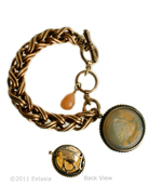 Hand pressed Butterscotch German glass intaglio bracelet. From our classic Daughters of Dust Collection, a bold bracelet with a  large, beautiful intaglio charm, and semi-precious drop. Butterscotch is a translucent stone, a warm, lightly marbled golden shade, one of our most popular stone colors. Charm measures 1 1/4 inch in diameter, domed shape with lovely carved leaf motif on the back. One half inch wide chain bracelet is adjustable from 7 1/2 to 8 inches. Bronze. Each bracelet is made to order in the U.S.A.