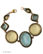 New Aqua & Jonquil Daughters of Dust classic style bracelet. Our hand pressedGerman glass intaglios in a lovely pastel combination for Spring, Summer. Center stone is 1 1/4 inches long. Bronze link bracelet is 7 1/2 inches. Each bracelet made to order in the U.S.A.