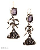 Transparent Amethyst German glass intaglio in a darling style with bow and antique watch fob drops. French hook style, the earring measures 1 3/4 inches long by 3/4 inches wide. Each earring made to order in the USA from the world's finest materials.