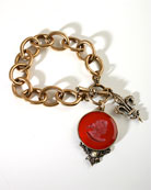Our bold new charm bracelet with an opaque wine German glass intaglio. The large round intaglio charm measures 1 1/4 inch in diameter and is paired with our classic Fleur de Lis charm. Substantial link chain makes this piece a simple and elegant statement. Available in all colors, call or email for details. Bronze. Each bracelet made to order in the U.S.A.