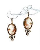 From our Elizabeth Collection, hand-carved Italian shell cameo earring. Classic styling for this cameo measuring 3/4 inch by 1/2 inch. Faux pearl accents. Bronze, French hook.