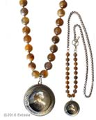 Our largest round intaglio featured in opaque Slate German glass on Botswana Agate hand knotted beads. Sporty with side toggle and mixed necklace. Pendant measures 1 1/2 inches in diameter. Necklace measures 33 inches in length. Shown in Silver Plate over bronze metal. Each necklace made to order in the USA from the world's finest materials.
