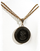 36 mm (1 1/2 inch diameter) jet black intaglio on a double bronze chain.  Simplicity at its best and an Extasia best seller.  Wear this 16 inch length necklace with jeans or a power suit and be perfectly accessorized. Adjustable to 20 inches. Bronze. Each necklace made to order in the USA.