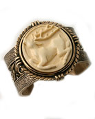 From our new Oak and Stag Collection, stunning hand-carved ivory cameo cuff bracelet. Ivory stag cameo measures 1 1/2 inches diameter. Beautiful metalwork cuff fits all wrists. Bronze. (US certified fossil ivory from ancient mammoth deposits. Please note that some ivory styles may require additional delivery time, rarely up to 4 weeks.)
