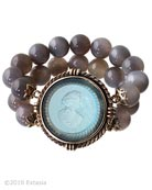 New from our Spring Collection, beautiful beaded Gray Agate bracelet with transparent Aqua German glass intaglio center. Aqua is a beautiful transparent Aquamarine color, one of our favorite blues! Each bead is 1/2 inch in diameter. One size fits all, beads are strung on elastic cord. This is a substantial piece. Metal and intaglio glass center piece is 1 3/4 inches in diameter. Bronze metal center. Each bracelet is hand made to order in USA.