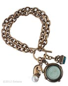 We love this new bracelet with an equestrienne theme! Includes a transparent Tourmaline green German glass intaglio charm, bronze horse with Freshwater Pearl charm, and small Zircon German glass intaglio fob charm. Largest round charm measures 1 inch in diameter. Bar and Toggle closure, Bronze metal. Each bracelet made to order in the USA.