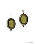From our Fleur de Lis Collection, a Moss hand-pressed German glass cameo earring. Classic styling, 1 inch by 5/8 inch, with a translucent color that is one of our most popular greens. In our signature bronze metal.