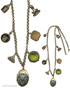 Mix and Match, that's the Victorian way. Four intaglios. two watch fobs, and one great locket. Periwinkle, Black Diamond, Butterscotch and Moss German glass intaglios. Oval Locket pendant is 1 1/2 by 1 inch. Necklace is 29 inches in length. In our signature Bronze metal. Each necklace made to order from the world's finest materials.