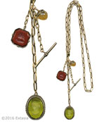 "Victorian styling is back on the fashion radar. 26 inch long Fob Style has two intaglios and decorative toggle. Shown in transparent Moss and opaque Marsala German glass intaglios. Oval pendant is 1 1/8 by 7/8 inch. Octagonal pendant is 7/8"". 26 inches length. Bronze metal. Each necklace made to order in the USA from the world's finest materials."