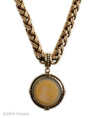Butterscotch translucent German glass intaglio in our large 1 1/2 inch diameter pendant. The substantial chain necklace is 18 inches in length. A very pretty color we love, a great neutral. Shown in our signature bronze.
