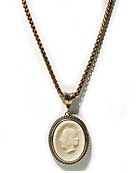 "New for Spring, our new Ivory German glass cameo on chain. Cameo is 1 1/2 by 1 1/4"" (36/24mm). This is a large size pendant, but very soft. Beautiful cameo image, classic styling. 18 inches. Bronze."