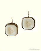 From our classical Mythos Collection, this 3/4 inch wide earring is in our flattering Ivory hand-pressed German glass. Glass is opaque, and a lovely light cream. In our signature bronze metal. French hook.