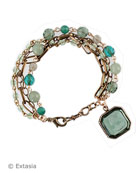 Tourmaline 3/4 inch octagon intaglio charm adorns a mixed chain and bead single charm bracelet, shown in transparent Aqua German glass intaglio. Aqua is one of our softest blues! Mixed semi precious and vintage glass beads. Bronze metal, each bracelet made to order in the USA from the worlds finest materials.