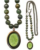 Sporty new look with mixed metal and beaded necklace for a fresh seasonal look, over sweaters and Fall's heavier fabrics. Shown in an Olivine German glass cameo, with hand knotted dyed Jade beads. Necklace is 29 inches in length. Pendant is 1 1/2 by 1 1/4 inches. Shown in our signature bronze. Each necklace made to order in the USA from the world's finest materials.
