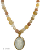 Our opaque ivory German glass cameo on a beautiful single strand of hand-knotted semiprecious beading. Our cameo, from Greek mythology, so popular as images in Victorian times, is 1 1/4 by 3/4 inch. Necklace of semi-precious stones, and Czech glass is 17 inches, adjustable to 20 inches. Shown in 14K Gold Plate, also available in Bronze. We love this very pretty necklace. Each necklace made to order in the U.S.A.