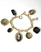 14K Gold Plate intaglio charm bracelet. Slate, jet and black diamond German glass intaglios look handsome in the 14K gold plate settings from our Portia Collection. Freshwater pearl accent. 7 1/2 inches length.