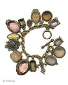 Our newest over the top charm bracelet. Shown here in a mix of Taupes and Neutrals, including our favorite Butterscotch. 15 hand pressed German glass cameos and intaglios and cameos. Measures almost 8 inches in length. Largest charm is 1 1/4 by 7/8 inch. Bronze, each bracelet made to order in the USA from the worlds finest materials.