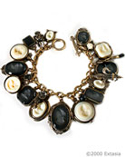 In classic black and white, multi-charm hand-pressed German glass intaglio charm bracelet. Largest charm is 1 1/4 by 1 inch. Bracelet length is 7 3/4 inches.