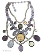 New for Fall, our Over The Top multi cameo/intaglio necklace. Stunning mix of neutrals and purples, the largest pendant measures 1 1/4 inches in diameter. Necklace measures 14 inches, interior strand to 18 inches, outer strand. Plus 3 inch adjustor to add length. Shown in our antique Silver Plate. Also available in our signature Bronze by request. Each necklace made to order in the USA, from the worlds finest materials.